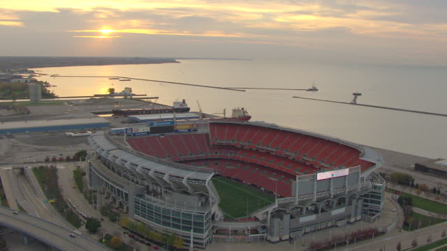 ws ds aerial view over cleveland browns stadium with lake erie / cleveland, ohio, united states - cleveland ohio stock videos & royalty-free footage