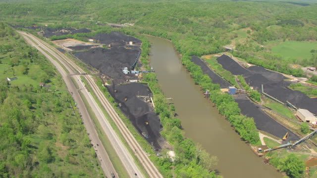 ws aerial view over coal center and ohio river and highway / kentucky, united states - ケンタッキー州点の映像素材/bロール
