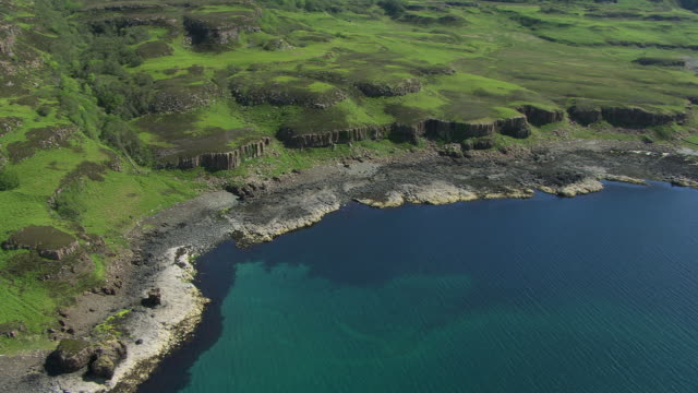 ws aerial ds view over coast of island of ulva near isle of mull in hebrides on west coast / isle of island of ulva, argyll and bute, scotland - hebrides stock videos & royalty-free footage