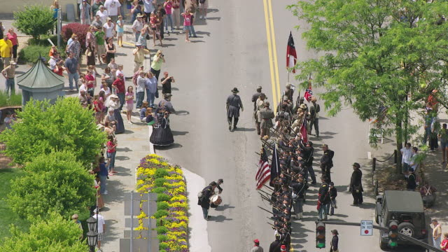 ms ts aerial view over confederate soldiers begin marching during lewisburg reenactment / fayetteville, west virginia, united states - confederate flag stock videos and b-roll footage