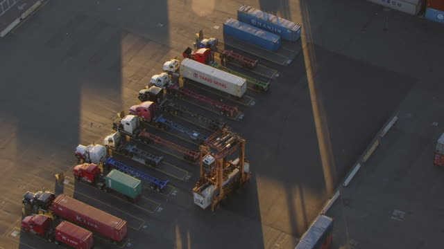 MS AERIAL ZO View over container transporter removes container from truck to Elizabeth Marine Terminal at port / Newark, New Jersey, United States