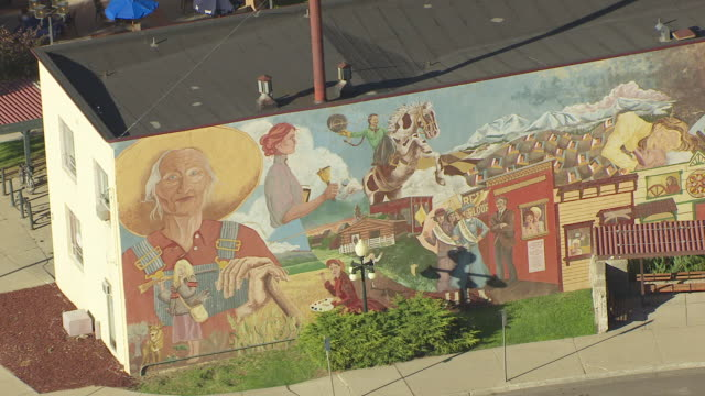 MS AERIAL ZO View over cowgirl and full mural on side of building / Helena, Montana, United States