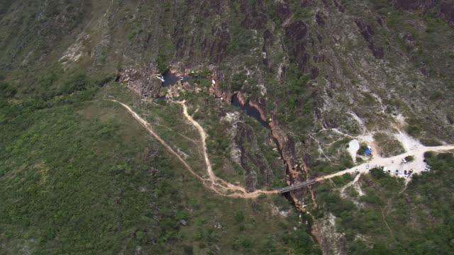 ws aerial view over crossing bridge near waterfall / minas gerais, brazil - minas stock videos and b-roll footage