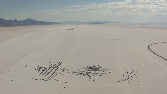 ws aerial view over crowd around timing tower at bonneville salt flats during speed week / utah, united states - bonneville salt flats stock videos and b-roll footage