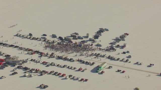 ws aerial ds view over crowd around timing tower during speed week at bonneville salt flats / utah, united states - bonneville salt flats stock videos and b-roll footage