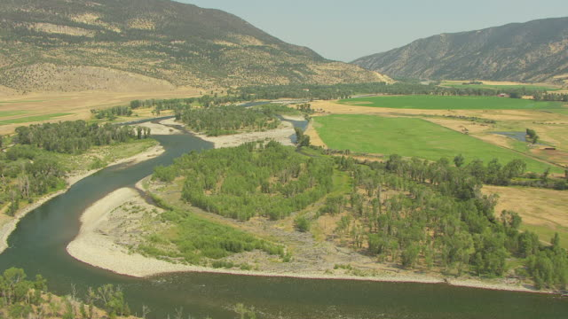 WS AERIAL View over curvy Yellowstone River / Montana, United States