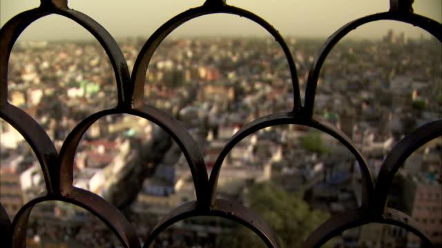 a view over delhi through metal grating. - delhi stock videos & royalty-free footage