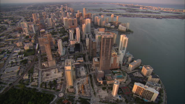 AERIAL WS View over downtown buildings north along Brickell Avenue / Miami, Florida, USA