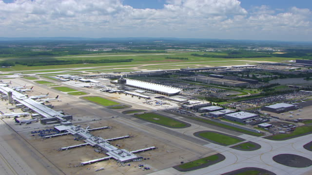 ws aerial pov view over dulles international airport station / washington dc, united states - dulles international airport stock videos and b-roll footage