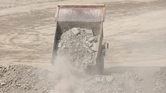 ms zo aerial view over dump truck pours out debris at hobet 21 mine and entire mine site / lincoln, west virginia, united states - kohlengrube stock-videos und b-roll-filmmaterial