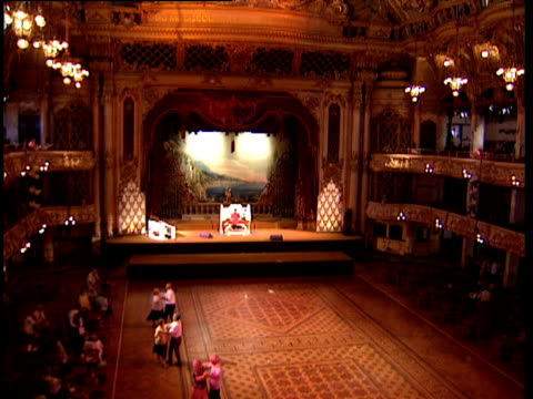 view over elderly couples dancing in ballroom man playing wurlitzer organ on stage tilt up to ornate ceiling surrounding glass roof feature - ballroom dancing stock videos & royalty-free footage