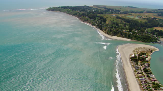 WS AERIAL View over end of Stinson Beach and Bolinas Lagoon toward town of Bolinas / Marin County, California, United States