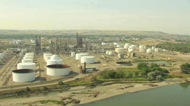 ws aerial view over exxon mobil refinery in yellowstone county / billings, montana, united states - exxon stock videos & royalty-free footage