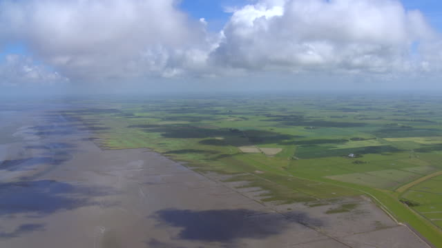 WS AERIAL View over farm filed in village at north sea / Sankt Pete Ording, Schleswig Holstein