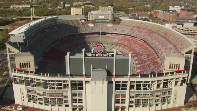 ws td aerial view over field at ohio state football stadium / columbus, ohio, united states - ohio state university stock videos & royalty-free footage