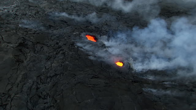 WS ZI AERIAL View over glowing lava from Volcano Kilauea on big island / Hawaii, United States