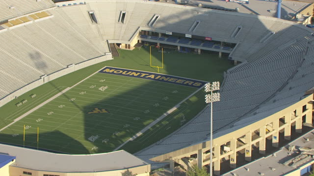 ms zi aerial view over goal posts and end zone at mountaineer field at west virginia university / morgantown, west virginia, united states - western script stock videos & royalty-free footage