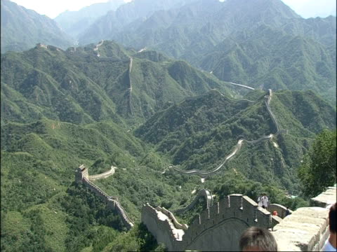 wa view over great wall of china snaking over forested mountains, badaling, china - badaling stock videos & royalty-free footage