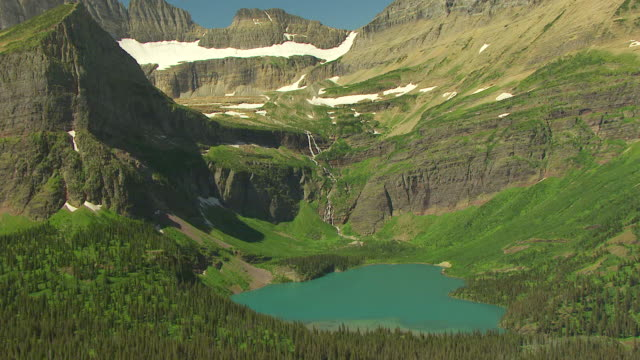 ws aerial view over grinnell glacier and grinnell lake in glacier national park / montana, united states - glacier national park us stock videos and b-roll footage