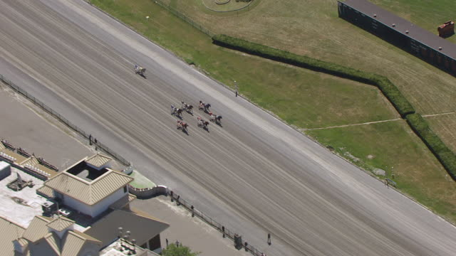 WS AERIAL TS View over harness race start at Freehold Raceway to horses / New Jersey, United States