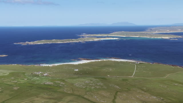 ws aerial view over hebrides with croft farms and sound of gunna with island of coll beyond and island of rum in distance / isle or island of tiree, argyll and bute, scotland - croft stock videos & royalty-free footage