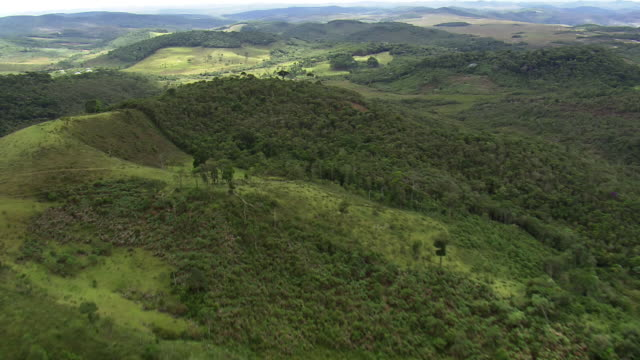 ws aerial view over hills / minas gerais, brazil - minas stock videos and b-roll footage