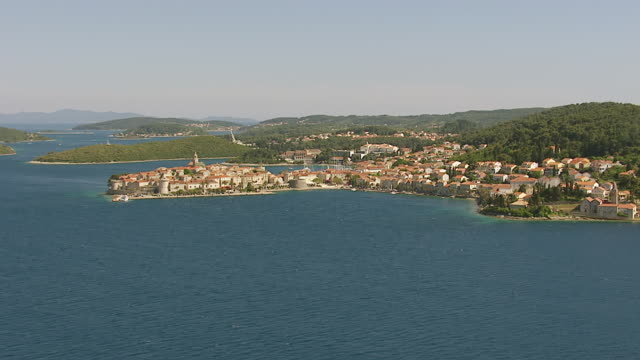 ws aerial view over historic fortified town along adriatic sea / korcula, dubrovnik neretva county, croatia - adriatic sea stock videos & royalty-free footage
