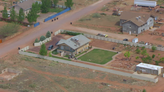 MS AERIAL View over home with yard / Hildale, Utah, United States