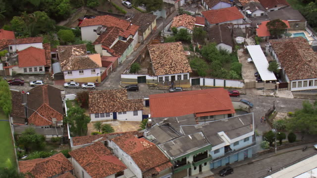 ws aerial view over house and streets in village / minas gerais, brazil - minas stock videos and b-roll footage