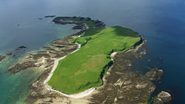 WS AERIAL View over island of Inch Kenneth with Gribben cliffs and mountain Ben More / Isle or island of Mull, Argyll and Bute, Scotland