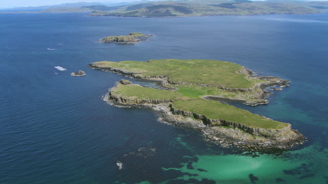 ws aerial td view over isles in hebrides on west coast with island of fladda passing over islands of cairn na burgh mor and cairn na burgh beag / isle or island of mull and treshnish, isles argyll and bute, scotland - cloud computing stock videos & royalty-free footage