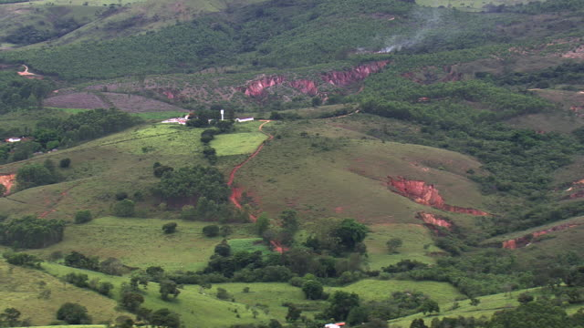 ws aerial view over landscape and mining area / minas gerais, brazil - minas gerais stock videos and b-roll footage