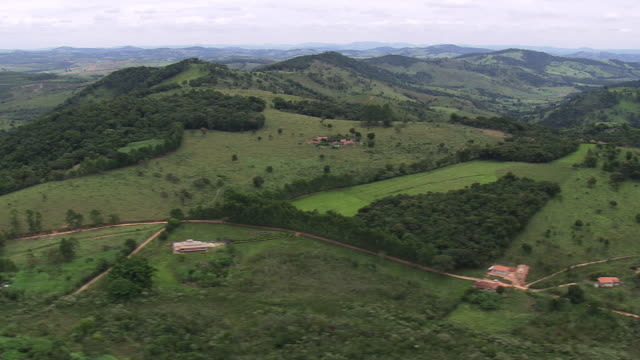 ws aerial view over landscape and small hills / minas gerais, brazil - minas stock videos and b-roll footage