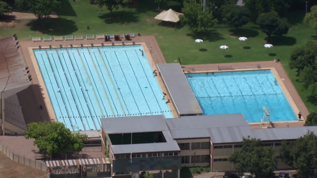 MS AERIAL View over large swimming pool / Bloemfontein, Free State, South Africa