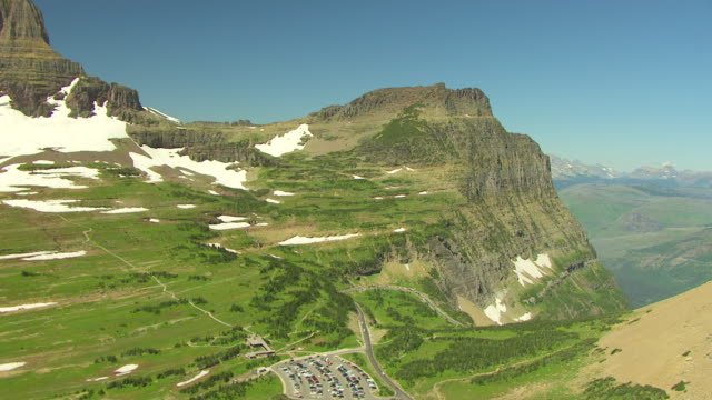 ws aerial view over logan pass with clements mountain and vast canyon / montana, united states - glacier national park us stock videos and b-roll footage