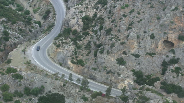 WS AERIAL TS View over long street in between mountains / Karpathos, Dodecanese, Greece