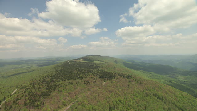 ws aerial view over mountain ridge in allegheny front toward spruce knob in pendleton county / west virginia, united states - knob stock videos and b-roll footage