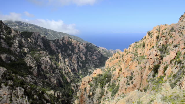 ws ha view over mountains of calanche of piana to sea, unesco world heritage site / porto, corsica, france - igneous stock videos & royalty-free footage