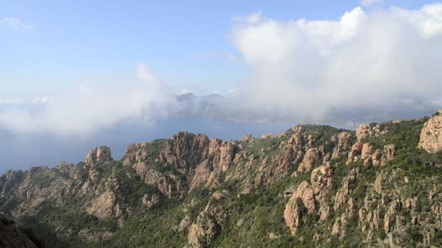 ws view over mountains of calanche of piana to sea, unesco world heritage site / porto, corsica, france - カランシェ点の映像素材/bロール