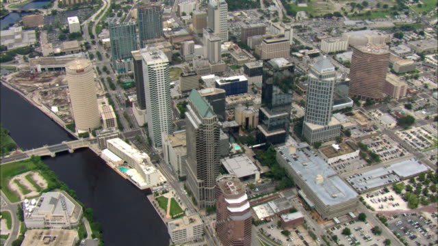 ws pov aerial view over multiple buildings, skyscrapers, and highways leading into downtown tampa / tampa, florida, usa - tampa stock videos & royalty-free footage
