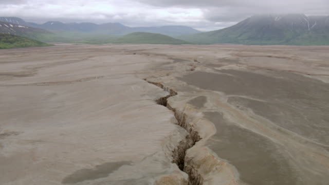 WS AERIAL View over narrow crevasse running along valley floor in Knife Creek Canyon at Valley of Ten Thousand Smokes / Alaska, United States