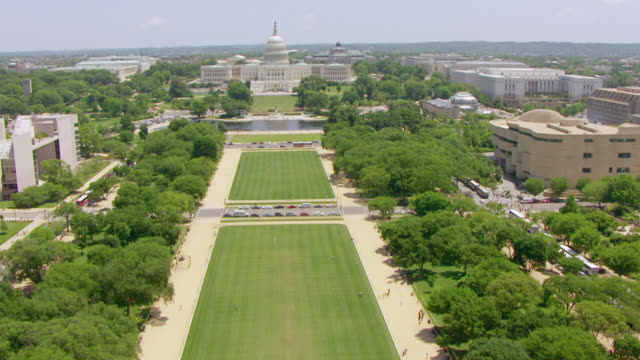 ws aerial pov view over national mall to us capitol building / washington dc, united states - capitol building washington dc stock videos & royalty-free footage
