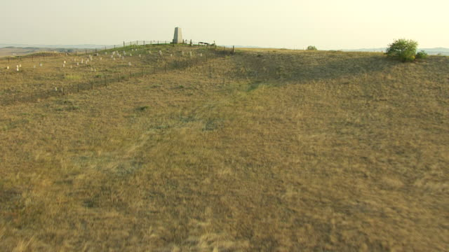 ws aerial view over native american route from little bighorn river at little bighorn battlefield / montana, united states - place concerning death stock videos and b-roll footage
