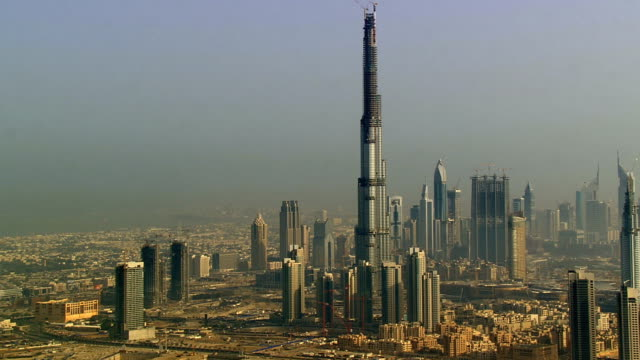aerial ws td view over of city including burj khalifa being built, dubai, united arab emirates - burj khalifa stock videos & royalty-free footage