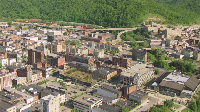 WS ZI AERIAL View over Ohio River and Independence Hall in Ohio County / Wheeling, West Virginia, United States