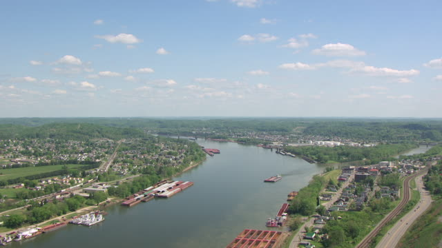 WS AERIAL View over Ohio River with barges in East Kentucky / Ashland, Kentucky, United States