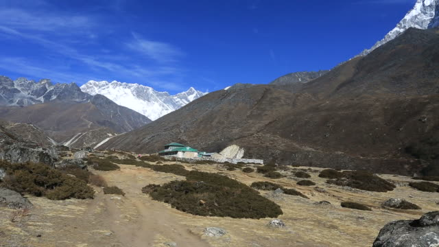 view over orsho village, exerest mountain range, sagarmatha national park, himalayan mountains, nepal - mt everest national park stock videos and b-roll footage