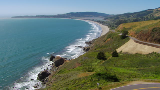 WS AERIAL View over Pacific Coast Highway approaching Stinson Beach / Marin County, California, United States