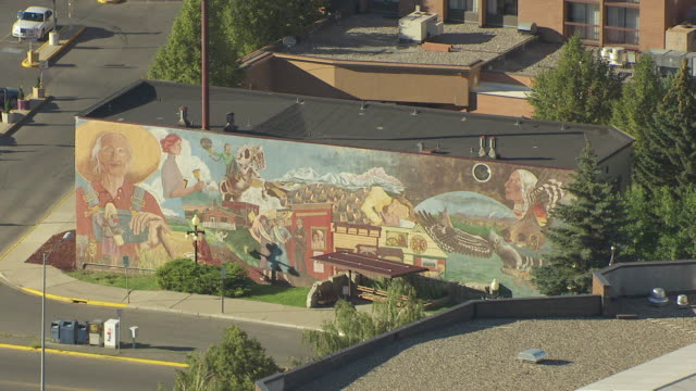 MS AERIAL View over painted mural on side of building / Helena, Montana, United States