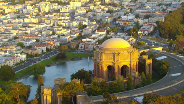 ws aerial view over palace of fine arts theater at sunset / san francisco, california, united states - palace video stock e b–roll